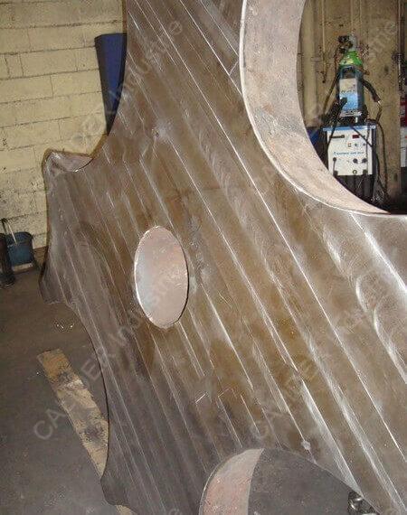 Réparation de cheminée - soudure et surfaçage de pied