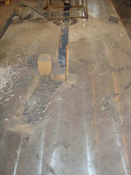 Réparation en cours d'une plaque de source
